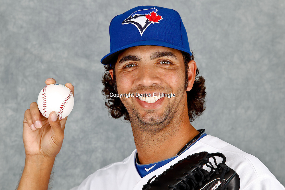 March 2, 2012; Dunedin, FL, USA; Toronto Blue Jays relief pitcher Nelson Figueroa (57) poses for a portrait during photo day at Florida Auto Exchange Stadium.  Mandatory Credit: Derick E. Hingle-US PRESSWIRE