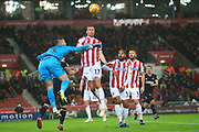 Stoke City goalkeeper Jack Butland (1) punches the ball away during the EFL Sky Bet Championship match between Stoke City and Derby County at the Bet365 Stadium, Stoke-on-Trent, England on 28 November 2018.