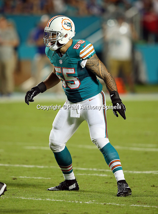 Miami Dolphins outside linebacker Koa Misi (55) makes a move during the NFL week 14 regular season football game against the New York Giants on Monday, Dec. 14, 2015 in Miami Gardens, Fla. The Giants won the game 31-24. (©Paul Anthony Spinelli)