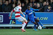 AFC Wimbledon defender Paul Osew (37) dribbling and taking on Doncaster Rovers defender Brad Halliday (2) during the EFL Sky Bet League 1 match between AFC Wimbledon and Doncaster Rovers at the Cherry Red Records Stadium, Kingston, England on 14 December 2019.