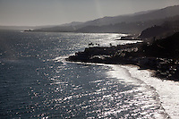 The rugged coastline of Malibu is lined with houses clinging to the shoreline.