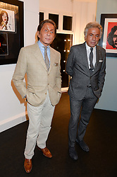 Left to right, VALENTINO and GIANCARLO GIAMMETTI at a private view of work by Andy Warhol at The Little Black Gallery, Park Walk, London SW10 on 22nd October 2013.
