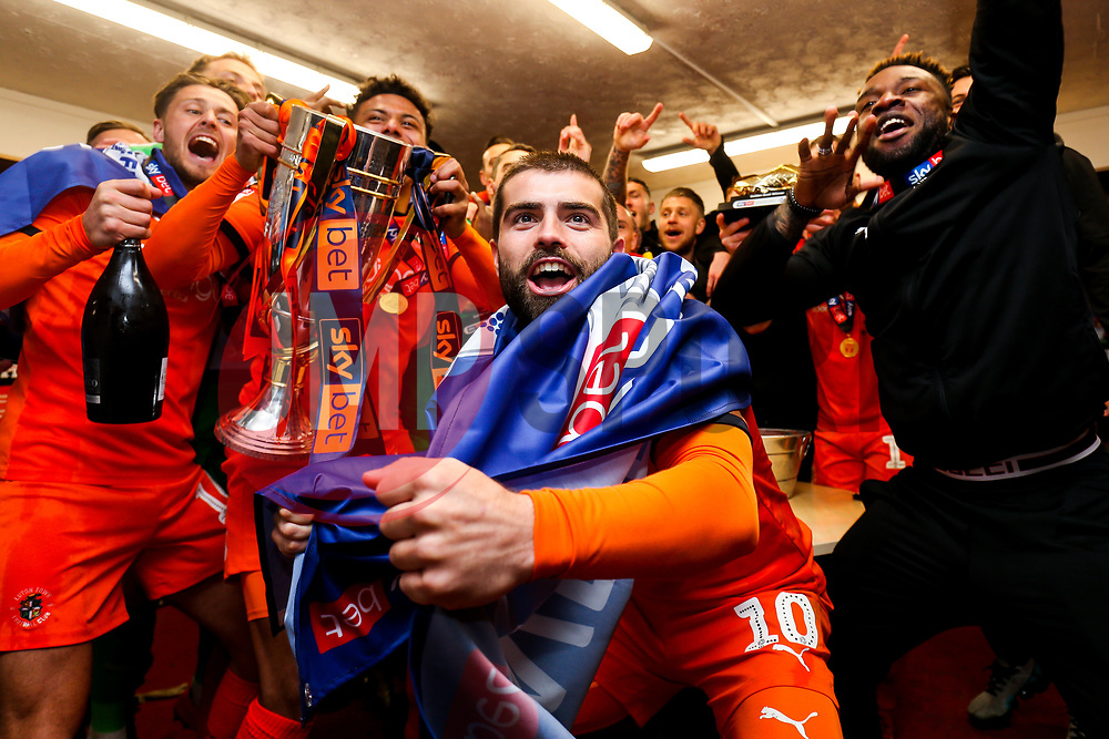 Elliot Lee looks on as Luton Town celebrate winning the league and securing automatic promotion from Sky Bet League 1 to the Sky Bet Championship - Rogan/JMP - 04/05/2019 - Kenilworth Road - Luton, England - Luton Town v Oxford United - Sky Bet League One.