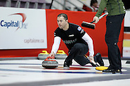 Blake MacDonald, third on Kevin Koe's team throws his rock in the team's first draw Wednesday.  The 2011 GP Car and Home Players' Championship ran April 12-17 at the Crystal Centre, Grande Prairie, AB..11-04-13, Photo Randy Vanderveen, Grande Prairie, Alberta.