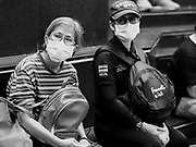 "14 JANUARY 2019 - BANGKOK, THAILAND:       Women wearing dust filters wait for a bus in Bangkok. Bangkok has been blanketed by heavily polluted air for almost a week. Monday morning, the AQI (Air Quality Index) for Bangkok  was 182, worse than New Delhi, Jakarta, or Beijing. The Saphan Kwai neighborhood of Bangkok recorded an AQI of 370 and the Lat Yao neighborhood recorded an AQI of 403. An AQI above 50 is considered unsafe. Public health officials have warned people to avoid ""unnecessary"" outdoor activities and wear breathing masks to filter out the dust.   PHOTO BY JACK KURTZ"