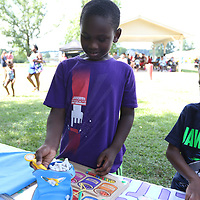 Jalyn Osborn, 7, plays one of the many games at Saturday's back to school event at Veterans park