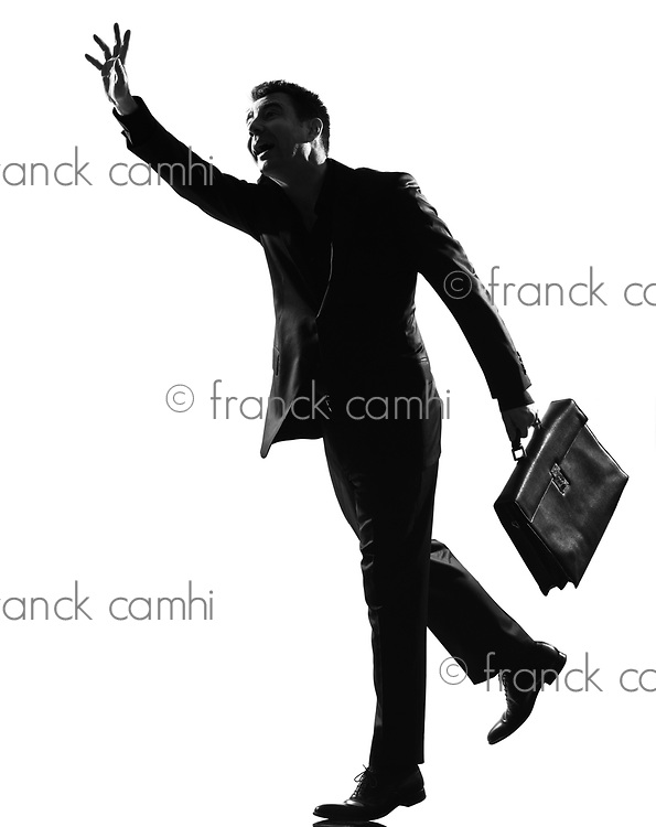 silhouette caucasian business man  running hailing full length on studio isolated white background