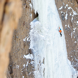 Aaron Mulkey climbing Joy After Pain in Cody, Wyoming