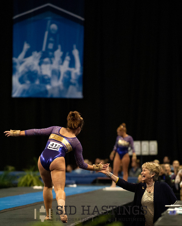 20 APRIL 2018 -- ST. LOUIS -- LSU gymnast Ruby Harold is congratulated by coach D-D Breaux in the Valut during the 2018 NCAA Women's Gymnastics Championship Semifinals in St. Louis Friday, April 20, 2018. LSU finished second in the semifinal, joining UCLA and Nebraska in advancing from the first semifinal into the Super Six championship round on Saturday.<br /> <br /> Photo &copy; copyright 2018 Sid Hastings.