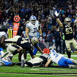 Oct 15, 2017; New Orleans, LA, USA; New Orleans Saints strong safety Kenny Vaccaro (32) dives on a fumble in the endzone as outside linebacker A.J. Klein (53) celebrates a touchdown against the Detroit Lions during the first quarter of a game at the Mercedes-Benz Superdome. Mandatory Credit: Derick E. Hingle-USA TODAY Sports