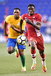 July 7, 2017 - Harrison, New Jersey, U.S - Canada midfielder ALPHONSO DAVIES (12) chases the ball downfield during CONCACAF Gold Cup 2017 action at Red Bull Arena in Harrison New Jersey Canada defeats French Guiana 4 to 2. (Credit Image: © Brooks Von Arx via ZUMA Wire)