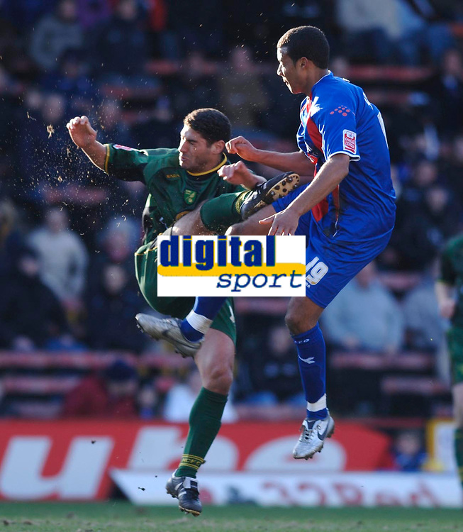 Photo: Daniel Hambury.<br />Crystal Palace v Norwich City. Coca Cola Championship. 25/02/2006.<br />Palace's Tom Soares (R) and Norwich's Youssef Safri battle. Safri was taken off injured after this challange.