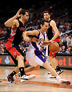 Mar. 23, 2011; Phoenix, AZ, USA; Phoenix Suns guard Steve Nash (15) is guarded by the Toronto Raptors guard Jose Calderon (8) the US Airways Center. The Suns defeated the Raptors 114-106. Mandatory Credit: Jennifer Stewart-US PRESSWIRE