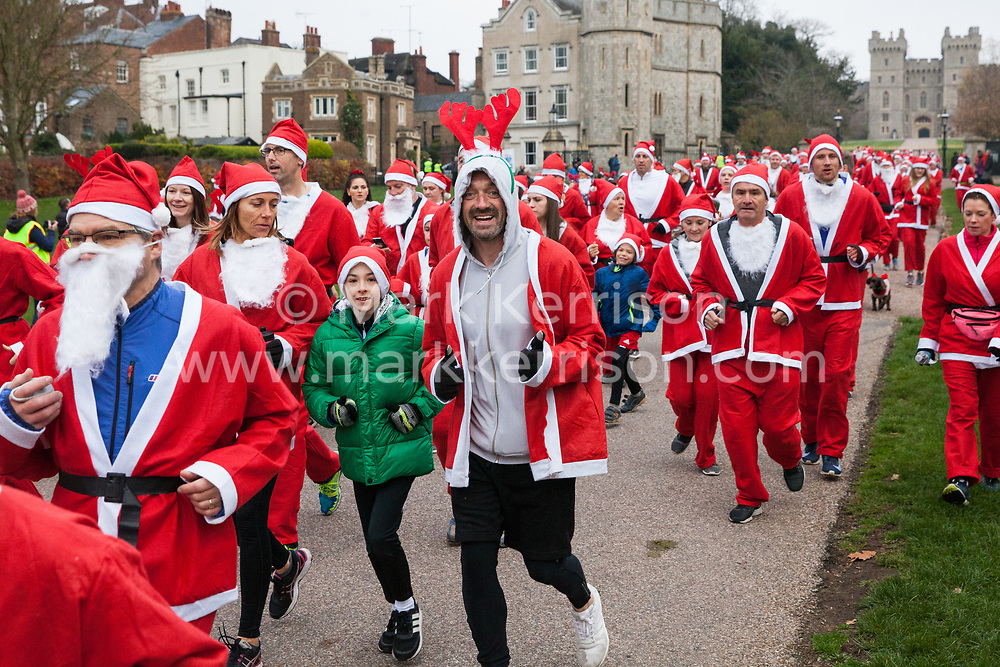 Windsor, UK. 25th November, 2018. Runners dressed as Santa Claus and his reindeer take part in the 2018 Santa Dash in aid of the Alexander Devine children's hospice on the Long Walk in Windsor Great Park.