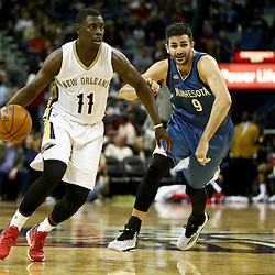 Feb 27, 2016; New Orleans, LA, USA; New Orleans Pelicans guard Jrue Holiday (11) drives past Minnesota Timberwolves guard Ricky Rubio (9) during the second half of a game at  the Smoothie King Center. The Timberwolves defeated the Pelicans 112-110.  Mandatory Credit: Derick E. Hingle-USA TODAY Sports