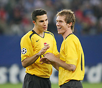 Photo: Chris Ratcliffe.<br /> Hamburg v Arsenal. UEFA Champions League, Group G. 13/09/2006.<br /> Robin Van Persie and Alexander Hleb of Arsenal are all smiles as they win a penalty.