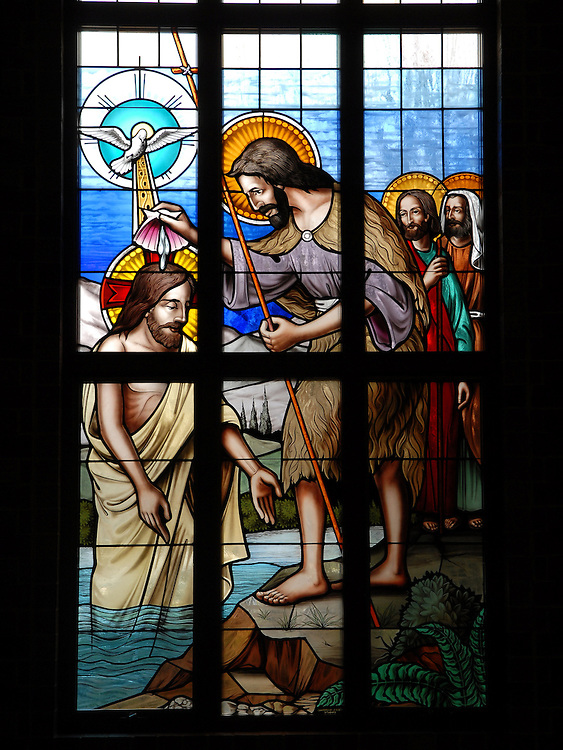 Stained glass image from St. William Church, Waukesha, depicts baptism of Jesus. (Photo by Sam Lucero)