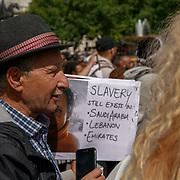 Trafalgar square, London, England, UK. 19th August 2017. A guy holding a placard written Slavery still exit in Saudi Arabia, Lebanon and Emirates.