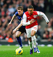 Picture by Andrew Tobin/Focus Images Ltd. 07710 761829. .21/01/12. Alex Oxlade-Chamberlain (15) of Arsenal on the ball during the Barclays Premier League match between Arsenal and Manchester United at Emirates Stadium, London.