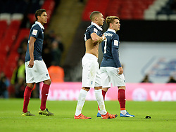 Kieran Gibbs of England puts on Bacary Sagna of France top on at full time. - Mandatory byline: Alex James/JMP - 07966 386802 - 17/11/2015 - FOOTBALL - Wembley Stadium - London, England - England v France - International Friendly