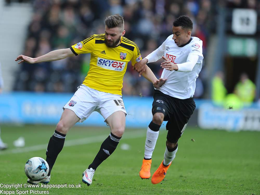 Stuart Dallas Brentford, battles with Jesse Kingard Derby,  Derby County, Derby County v Brentford, Sky Bet Championship, IPro Stadium, Saturday 11th April 2015. Score 1-1,  (Bent 92) (Pritchard 28)<br /> Att 30,050