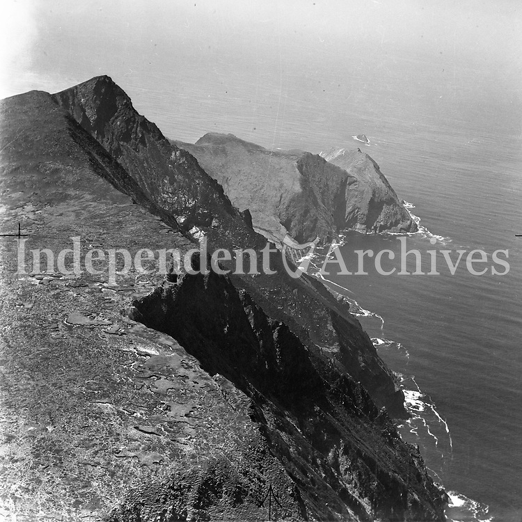 A2 Achill Head.   No Date. (Part of the Independent Newspapers Ireland/NLI collection.)<br /> <br /> <br /> These aerial views of Ireland from the Morgan Collection were taken during the mid-1950's, comprising medium and low altitude black-and-white birds-eye views of places and events, many of which were commissioned by clients. From 1951 to 1958 a different aerial picture was published each Friday in the Irish Independent in a series called, 'Views from the Air'.<br /> The photographer was Alexander 'Monkey' Campbell Morgan (1919-1958). Born in London and part of the Royal Artillery Air Corps, on leaving the army he started Aerophotos in Ireland. He was killed when, on business, his plane crashed flying from Shannon.