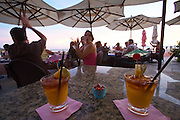 "Sunset at Waikiki Beach. The Mai Tai bar at the historic Royal Hawaiian Hotel, also known as the ""Pink Lady"". Original Mai Tais."