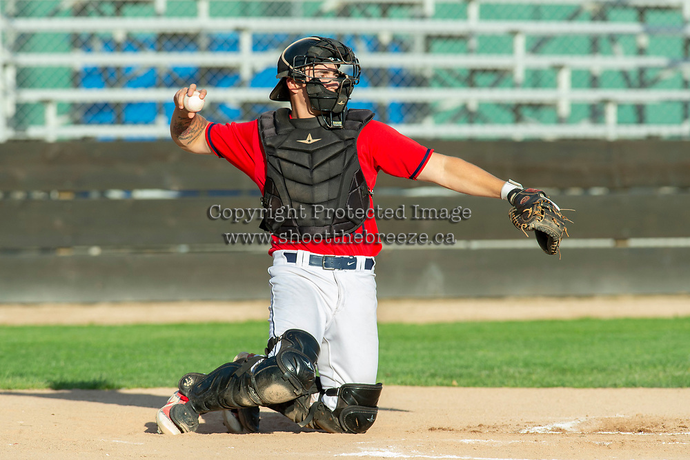 KELOWNA, BC - JULY 17:  Jake Fischer #19 of the Kelowna Falcons returns the ball to the pitcher against the Wenatchee Applesox at Elks Stadium on July 17, 2019 in Kelowna, Canada. (Photo by Marissa Baecker/Shoot the Breeze)