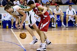 Uros Slokar of Olimpija vs Vuk Radivojevic at basketball match of NLB League between KK Union Olimpija and KK Crvena zvezda,  on October 24, 2009, Arena Tivoli, Ljubljana, Slovenia.  Union Olimpija won 94:76.  (Photo by Vid Ponikvar / Sportida)