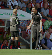Marinus Dijkhuizen berating the fourth official during the Sky Bet Championship match between Brentford and Ipswich Town at Griffin Park, London, England on 8 August 2015. Photo by Matthew Redman.