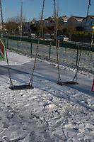 Snow covered playground in suburban in Dublin Ireland