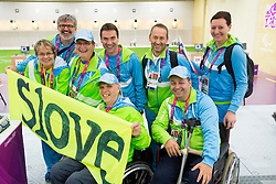 Polonca Sladic, Roman Jakic, Damjan Pavlin, Franc Pinter, Bojan Ceru, Ales Kosmac, Francek Gorazd Tirsek and Katarina Tonin of Slovenia after the Men's R5-10m Air Rifle Prone shooting Qualifications during Day 4 of the Summer Paralympic Games London 2012 on September 1, 2012,  in Royal Artillery Barracks, London, Great Britain. (Photo by Vid Ponikvar / Sportida.com)