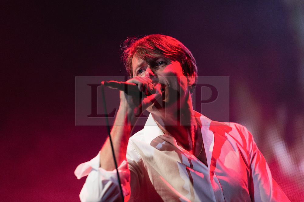© Licensed to London News Pictures. 23/08/2013. London, UK.   Suede performing live at Kenwood House as part of the Live on the Lake series of live music events.  In this pic - Brett Anderson. Suede are an English alternative rock band from London, formed in 1989, composed of band members Brett Anderson (vocals), Mat Osman (bass), Simon Gilbert (drums), Richard Oakes (lead guitar) and Neil Codling (keyboards & rhythm guitar). Photo credit : Richard Isaac/LNP