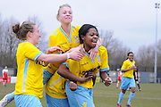 Steph Mann, Sarah Jones and goalscorer Roschelle Shakes celebrate levelling the game during the Women's FA Cup match between Charlton Athletic WFC and Crystal Palace LFC at Sporting Club Thamesmead, Thamesmead, United Kingdom on 8 March 2015. Photo by Michael Hulf.