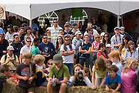 In August the annual cheese rolling contest brings athletic contestants to Whistler, BC, Canada. The first to catch the rolling cheese as it heads down Blackcomb Mountain wins a seasons' ski pass. Spectators line the course.