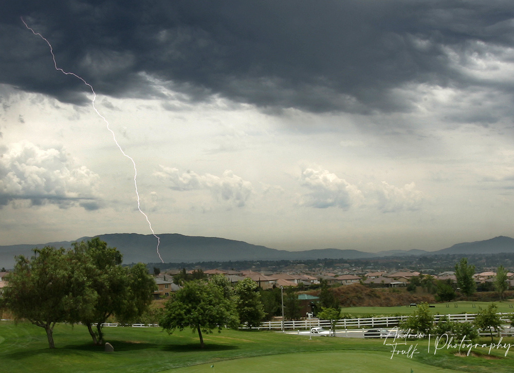A lightning bolt races to the ground in Murrieta Wednesday afternoon as a large thunder storm made its way through South West Riverside county.