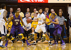 Feb 13, 2016; Morgantown, WV, USA; West Virginia Mountaineers forward Esa Ahmad (23) backs down TCU Horned Frogs guard Brandon Parrish (11) during the first half at the WVU Coliseum. Mandatory Credit: Ben Queen-USA TODAY Sports