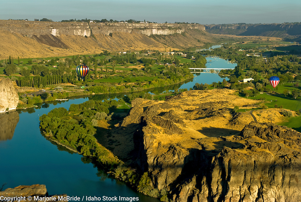 Hot air balloons flying above the Snake River in the canyon, Twin Falls, Idaho.