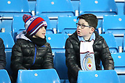 Young fans plan the teams during the Premier League match between Manchester City and Newcastle United at the Etihad Stadium, Manchester, England on 20 January 2018. Photo by George Franks.
