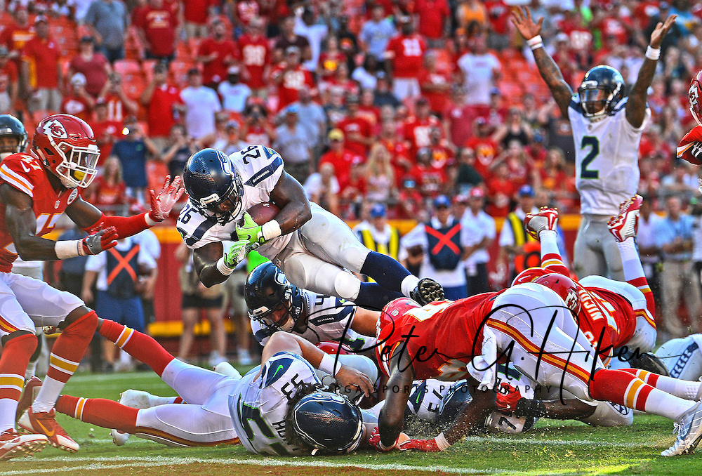 Running back Troymaine Pope #26 of the Seattle Seahawks dives over the goal line for the game winning two point conversion against the Kansas City Chiefs during the second half at Arrowhead Stadium in Kansas City, Missouri.