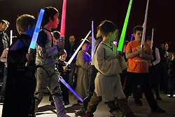 "© Licensed to London News Pictures . 06/12/2015 . Manchester , UK . Lightsabre training . Fans attend Star Wars exhibition "" For the Love of the Force "" at Bowlers Exhibition Centre in Manchester . Photo credit : Joel Goodman/LNP"