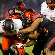 10 November 2018: San Diego State Aztecs safety Tariq Thompson (14) strips the ball out of UNLV Rebels running back Lexington Thomas (3) in the second quarter. The ball rolled out of bounds and UNLV retained possession. The Aztecs lost 27-24 to UNLV Saturday night at SDCCU Stadium falling a game behind Fresno State in the conference standings.