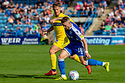 Wycombe Wanderers midfielder Dominic Gape (4) and Gillingham FC midfielder Mark Byrne (18) during the EFL Sky Bet League 1 match between Gillingham and Wycombe Wanderers at the MEMS Priestfield Stadium, Gillingham, England on 14 September 2019.