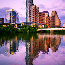 Austin Skyline reflection at dusk with downtown Austin buildings along the Colorado River. Austin Texas is a major city in the Southwestern United States of America. Photo was taken in 2016.