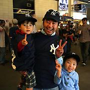 New York Yankees fans from Japan during the game with Masahiro Tanaka, New York Yankees, pitching during the New York Yankees V Tampa Bay Rays, Major League Baseball game at Yankee Stadium, The Bronx, New York. 3rd May 2014. Photo Tim Clayton