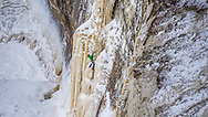 North Face athlete and Michigan native Sam Elias puts up his route Fallen Feather a hard line in the backcountry of Pictured Rocks National Lakeshore near Munising, Michigan.