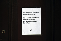 Reduced opening hours at Lloyds Bank during Coronavirus lockdown, Norwich UK April 2020