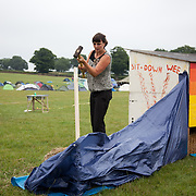 Its hard work to set up the camp to facilitate up to 1000 visitors. Straw bales are essential for compost toilets and they need to be kept out of the rain. Reclaim the Power camp is set up in a field near Balcombe. The site is squatted but so far nor the owner nor police has made any moves to stop the camp from setting up. It is organised by the environmental group No Dash for Gas and the movement is protesting against the company Cuadrilla's fracking testing near Balcombe and have come to Balcombe to lend its support to the local protests against the drilling for gas.