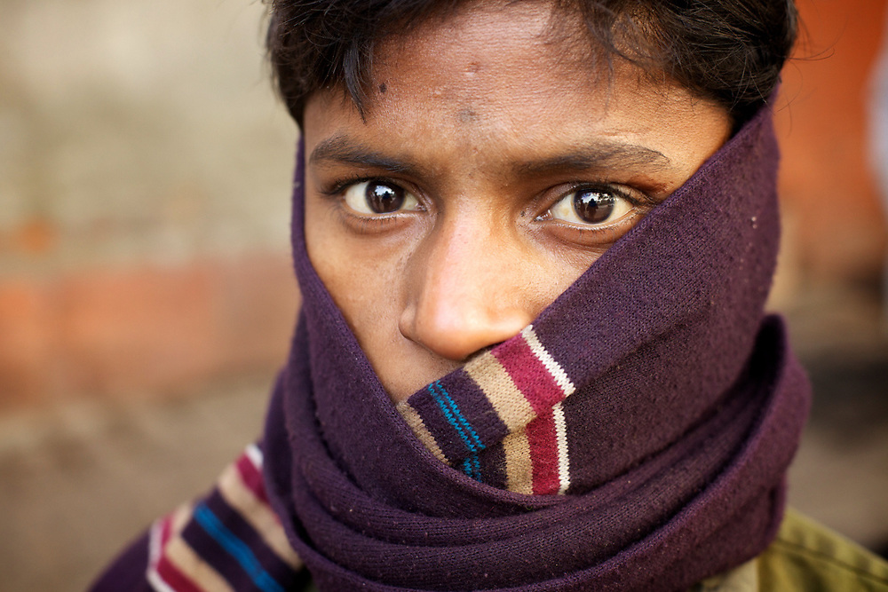Street portrait of an indian boy in Old Delhi, India.