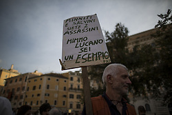 October 2, 2018 - Rome, Italy - A demonstrator holds a placard during a demonstration in  support of Riace mayor Domenico 'Mimmo' Lucano in Rome, on October 02, 2018. Lucano was put under house arrest today in relation to allegations of aiding illegal immigration, prosecutors said. (Credit Image: © Christian Minelli/NurPhoto/ZUMA Press)